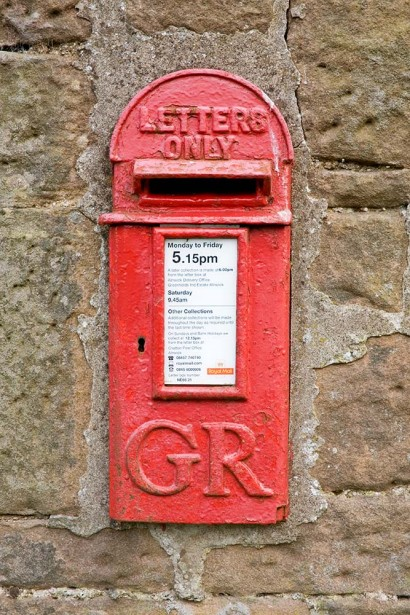 'Letters only' style postbox dating from the reign of King George the Fifth, East Horton, Northumberland, England